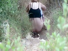 Voyeur stalks her when she squats to pee
