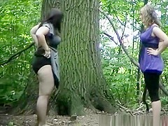 Chubby blonde and brunette peeing outside