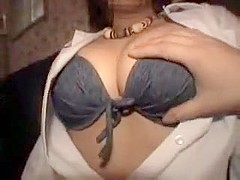 Beautiful Japanese girl flashes her big hooters and her tig