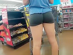 Girl in spandex black shorts at the supermarket