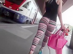 Hot sexy blonde in high heels and leggings
