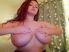 Busty college girl oiling her boobs