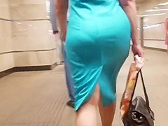 Woman s ass in turquoise dress