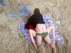 Clothed woman fucked in the beach