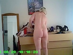 Woman spied in her bedroom dressing