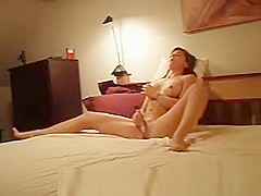 Masturbation in bed with vibrator