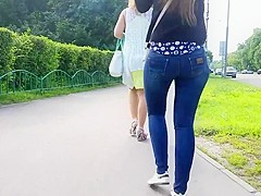 Girl with wide sexy round ass talk on the phone
