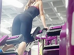 Fit brunette girl spied in the gym exercising
