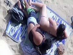 Spooning and fucking on the beach