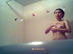 Asian woman spied showering in bathtub