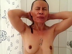 Asian woman with dark nipples and aureola showering