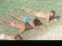 Nudist chick and friends in beach