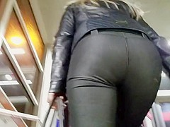Nice blonde with small round ass in tight pants