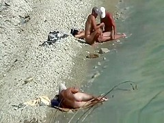 Two nudist couples spied at rocky beach