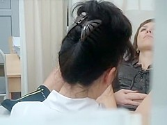 Woman with legs spread in gynecologist chair