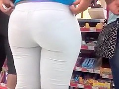 Curvy shopper with a big booty in skintight white pants is