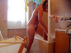 Young sis is spied naked in the bathroom