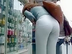 Tight pants woman bending over