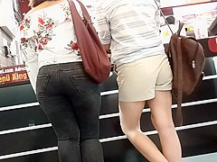 two sexy girls show butts