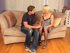 Blonde big tits milf in stockings fucks on the sofa