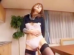 Lustful Asian housewife in stockings finds a way to please