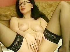 Busty brunette milf in eyeglasses represents sexy about the