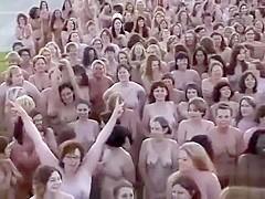 Hundreds of nudists strip for a camera man