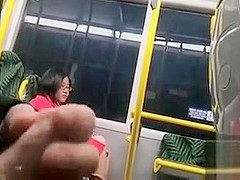 Dude beats off on a lovely Asian lady in the train