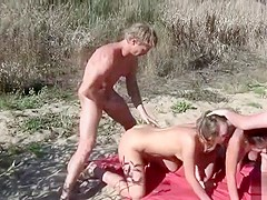 Blowjob foursome with ugly Russian chicks on a sandy beach