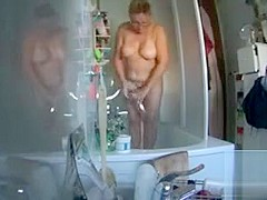 My wife washes her chubby body in the shower cabin