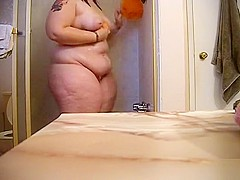 My brother's fat wife takes a long and relaxing shower in the bathroom
