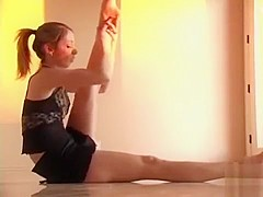 Flexible ballerina shows off her moves and her panties