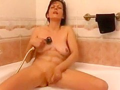 While she's bathing milf fucking herself