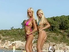 G-string bikinis on blondes at the beach