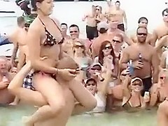 Sexy beach girls fighting each other from the shoulders of their boyfriends
