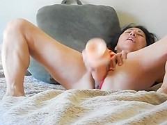 Milf with a huge dildo