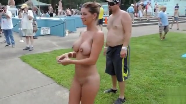 Naughty nudist does a headstand for the crowd