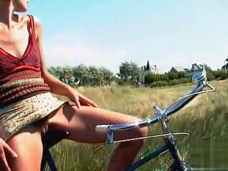 French girl relieves herself on a country bike ride