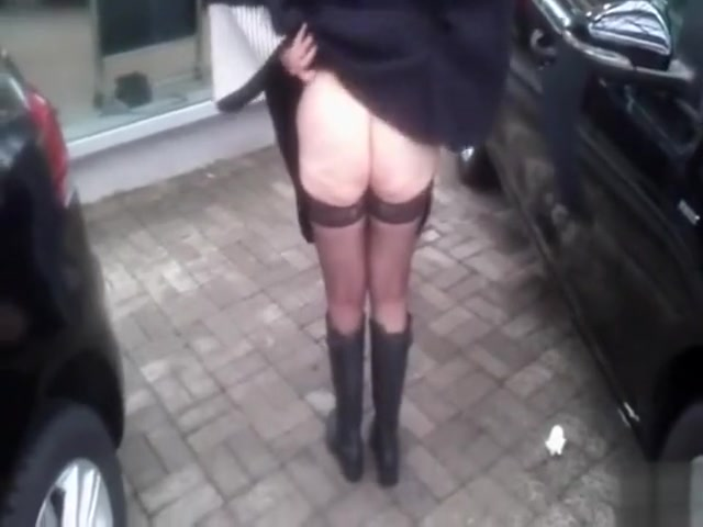 Public urinating with woman in sexy stockings