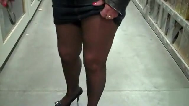 Wife in stockings and heels in the hardware store
