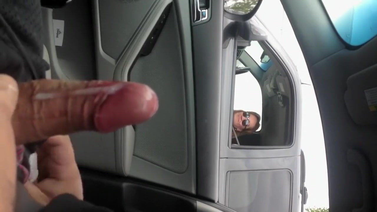 Jerking off at a stoplight as a woman watches