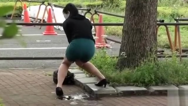 Beautiful Asian girl accidentally pisses in public