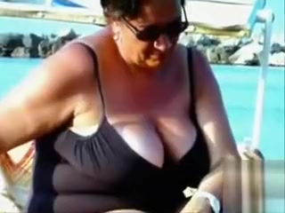 Large saggy breasts in bikini tops by the pool