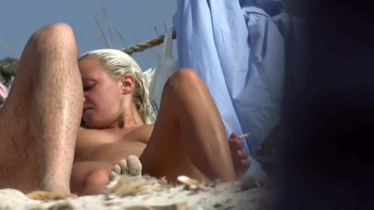 Naked tanned blonde puts her bikini back on