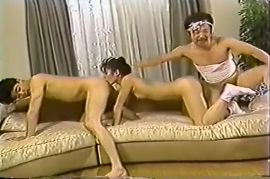 Pretty Japanese Girl Takes On 2 Cocks