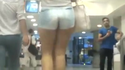 Candid milf ass in jean shorts in subway