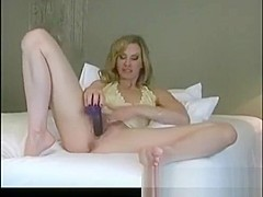 Horny blonde MILF plays with her black dildo