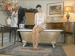 MILF in sheer stockings masturbating in the bath