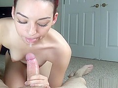 Redhead oils up a big dick for a handjob
