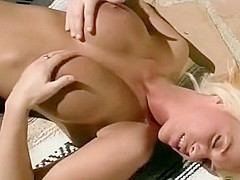 Sexy blonde lesbians with big tits toy with one another